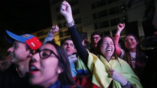 BOGOTA, COLOMBIA - OCTOBER 02:  'No' supporters celebrate following their victory in the referendum on a peace accord to end the 52-year-old guerrilla war between the FARC and the state on October 2, 2016 in Bogota, Colombia. The guerrilla war is the longest-running armed conflict in the Americas and has left 220,000 dead. The plan called for a disarmament and re-integration of most of the estimated 7,000 FARC fighters. Colombians have voted to reject the peace deal in a very close vote.  (Photo by Mario Tama/Getty Images)