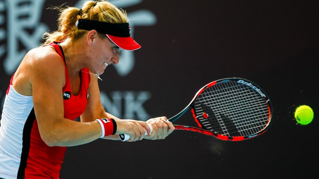 BEIJING, CHINA - OCTOBER 05:  Timea Babos of Hungary returns a shot against Johanna Konta of Great Britain during the Women's singles second round match on day five of the 2016 China Open at the China National Tennis Centre on October 5, 2016 in Beijing, China.  (Photo by VCG/VCG via Getty Images)
