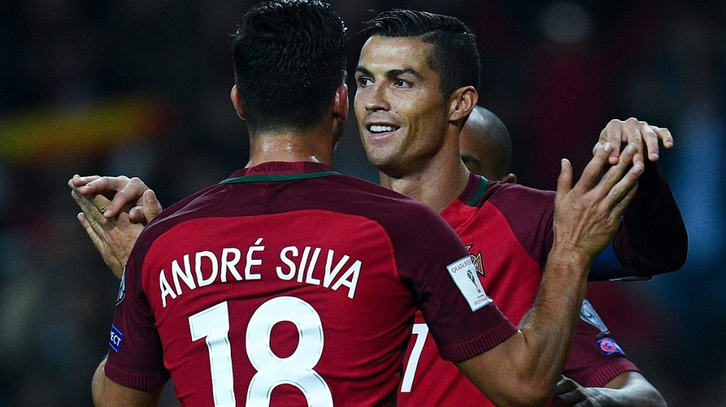 AVEIRO, PORTUGAL - OCTOBER 07:  Cristiano Ronaldo of Portugal celebrates with his team mate Andre Silva after scoring his team's fourth goal during the FIFA 2018 World Cup Qualifier between Portugal and Andorra at Estadio Municipal de Aveiro on October 7, 2016 in Aveiro, Portugal.  (Photo by David Ramos/Getty Images)