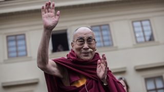 PRAGUE, CZECH REPUBLIC - OCTOBER 17: The Dalai Lama gestures as he attends a gathering with his supporters at the Hradcanske Square in front of Prague Castle on October 17, 2016 in Prague, Czech Republic. It is the first stop during his visit to the Czech Republic where he will attend the Forum 2000 Conference. (Photo by Matej Divizna/Getty Images)