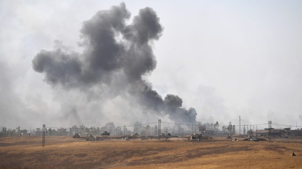 MOSUL, IRAQ - OCTOBER 20:  Smoke billows from a combined aircraft, artillery and ground attack to recapture the village of Tiskharab from ISIS on October 20, 2016 near Mosul, Iraq. Kurdish and Iraqi forces, supported by numerous countries including Britain and the USA, have continued their advance towards towards Iraq's second largest city of Mosul which has been held by Islamic State militants since 2014.  (Photo by Carl Court/Getty Images)