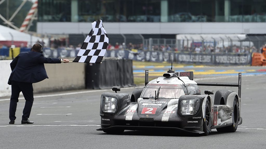 Switzerland's Neel Jani takes the Porsche 919 Hybrid N°2 over the finish line to win the 84th Le Mans 24-hours endurance race, on June 19, 2016 in Le Mans, western France. Porsche snatched their 18th Le Mans 24 Hour Race victory in the most dramatic of circumstances after Toyota suffered engine failure with just three minutes left on June 19, 2016. / AFP / JEAN-SEBASTIEN EVRARD        (Photo credit should read JEAN-SEBASTIEN EVRARD/AFP/Getty Images)