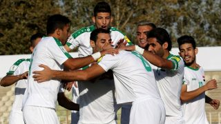 Iraq's Mohannad Abdul-Raheem Karrar (C) celebrates with teammates after scoring a goal against Thailand during their 2018 World Cup qualifying football match at Shahid Dastgerdi Stadium in the Iranian capital Tehran, on October 11, 2016. / AFP PHOTO / STRINGER