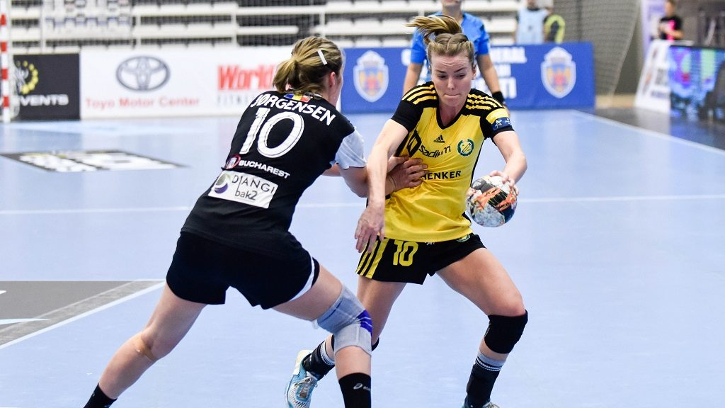 "November 20, 2015: Stine Lund Andreassen #10 of IK Savehof and Line Anna Ryborg Jorgensen #10 of CSM Bucharest in action during the Woman's European Handball Federation (EHF) Champions League game between  CSM Bucharest (ROU) vs IK Savehof (SWE) at Polyvalent Hall ""Dinamo"" in Bucharest, Romania."