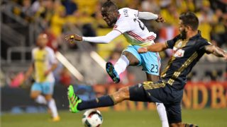 COLUMBUS, OH - MARCH 12: Kei Kamara #23 of the Columbus Crew SC launches a shot to the net past the defense of Richie Marquez #16 of the Philadelphia Union in the second half on March 12, 2016 at MAPFRE Stadium in Columbus, Ohio. Philadelphia defeated Columbus 2-1.   Jamie Sabau/Getty Images/AFP
