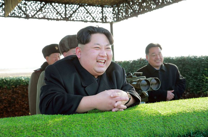 "This undated picture released from North Korea's official Korean Central News Agency (KCNA) on February 27, 2016 shows North Korean leader Kim Jong-Un smiling during the inspection of the test-fire of a newly developed anti-tank guided weapon at an undisclosed location.  North Korea on February 27 boasted of a newly developed anti-tank weapon that its leader said was so powerful it could turn the most heavily armoured enemy tanks into ""boiled pumpkin"".      REPUBLIC OF KOREA OUT     AFP PHOTO / KCNA via KNS 