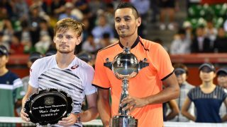 Nick Kyrgios of Australia (R) and runner-up Belgium's David Goffin (L) pose during the awards ceremony after the men's singles final at the ATP Japan Open tennis tournament in Tokyo on October 9, 2016. / AFP PHOTO / KAZUHIRO NOGI