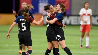 MINNEAPOLIS, MN - OCTOBER 23: Kelley O'Hara #5, Carli Lloyd #10 and Andi Sullivan #19 of United States celebrate a goal by Lloyd against Switzerland during the first half of the friendly match on October 23, 2016 at US Bank Stadium in Minneapolis, Minnesota.   Hannah Foslien/Getty Images/AFP