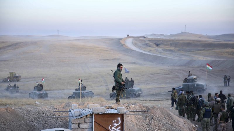 MOSUL, IRAQ - OCTOBER 17 : Peshmerga forces stand guard at Hazer region's Wardak village during an operation to retake Iraq's Mosul from Deash in Iraq on October 17, 2016. A much anticipated Mosul offensive to liberate the city from Daesh began midnight Sunday, according to Iraqi Prime Minister Haider al-Abadi. Emrah Yorulmaz / Anadolu Agency