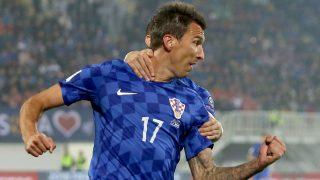 Croatia's Mario Mandzukic celebrates after scoring during the World Cup 2018 qualifying football match between Kosovo and Croatia at Loro Borici Stadium in Shkoder on October 6, 2016. / AFP PHOTO / GENT SHKULLAKU