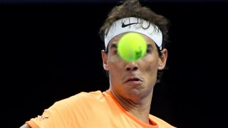 Rafael Nadal of Spain hits a return against Grigor Dimitrov of Bulgaria during men's singles quater-finals match at the China Open tennis tournament in Beijing on October 7, 2016. / AFP PHOTO / WANG ZHAO
