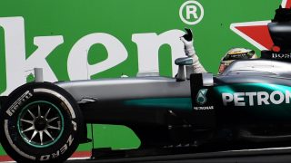 Mercedes AMG Petronas F1 Team British driver Lewis Hamilton celebrates at the end of the Formula One Mexico Grand Prix at the Hermanos Rodriguez circuit in Mexico City on October 30, 2016. Lewis Hamilton kept his world championship hopes alive with victory in the Mexican Grand Prix, Mercedes team-mate Nico Rosberg edged closer to the crown with a second-place finish. Sebastian Vettel, in a Ferrari, was third.  / AFP PHOTO / PEDRO PARDO
