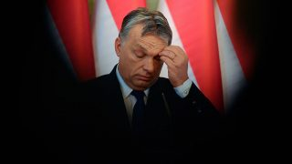 """Hungarian Prime Minister Viktor Orban addresses a press conference at the Delegation Hall of the parliament building in Budapest on February 24, 2016.  Hungary will hold a referendum on whether to accept mandatory EU quotas for migrants, Prime Minister Viktor Orban said, protesting that Brussels has no right to """"redraw Europe's cultural and religious identity."""" / AFP PHOTO / ATTILA KISBENEDEK"""
