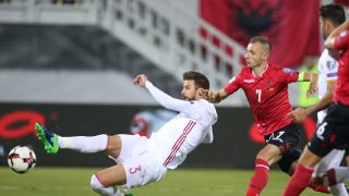Albania's Ansi Agolli (R) vies with Spain's Gerard Pique (L) during the FIFA World Cup 2018 qualification football match Albania vs Spain at the Loro-Borici stadium in Shkoder, on October 9, 2016. / AFP PHOTO / GENT SHKULLAKU