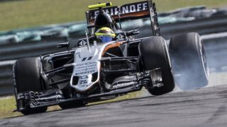 Sahara Force India F1 Team's Mexican driver Sergio Perez takes a corner during the Formula One Malaysian Grand Prix in Sepang on October 2, 2016.  / AFP PHOTO / PEDRO UGARTE