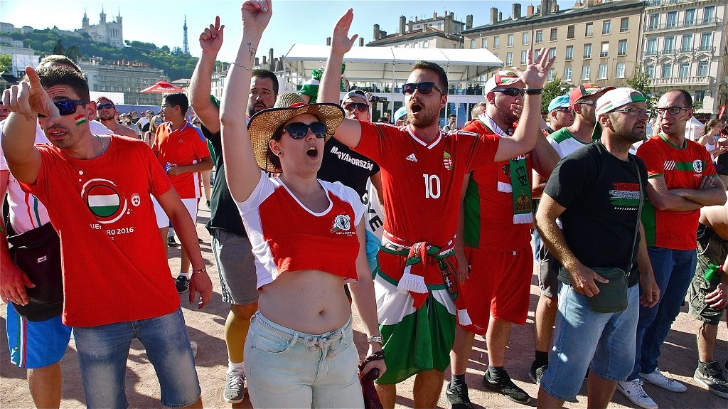 LYON, FRANCE - JUNE 22: Hungarian supporters look on as they attend the live broadcasting of the EURO 2016 football championship match between Hungary and Portugal.  (Photo by Serge Mouraret/Corbis via Getty Images)