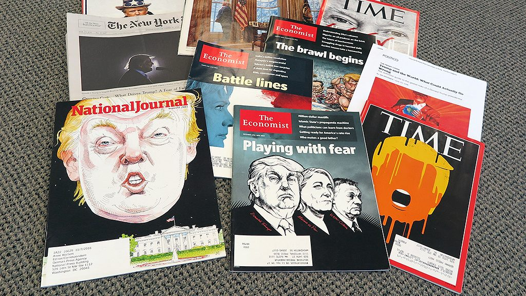 Different magazines and newspapers presenting pictures of Presidential Candidate Donald Trump, photographed in Washington, US, 27 October 2016. The relationship between the republican and the media is tense. PHOTO: MARTIN BIALECKI/dpa