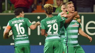 Bremen's Robert Bauer, Lennart Thy (r), Zlatko Junuzovic (l) and Serge Gnabry (2nd l) celebrating the 1:1 goal during the German Bundesliga soccer match between Werder Bremen and VfL Wolfsburg in the Weserstadion in Bremen, Germany, 24 September 2016. Photo: CARMEN JASPERSEN/dpa