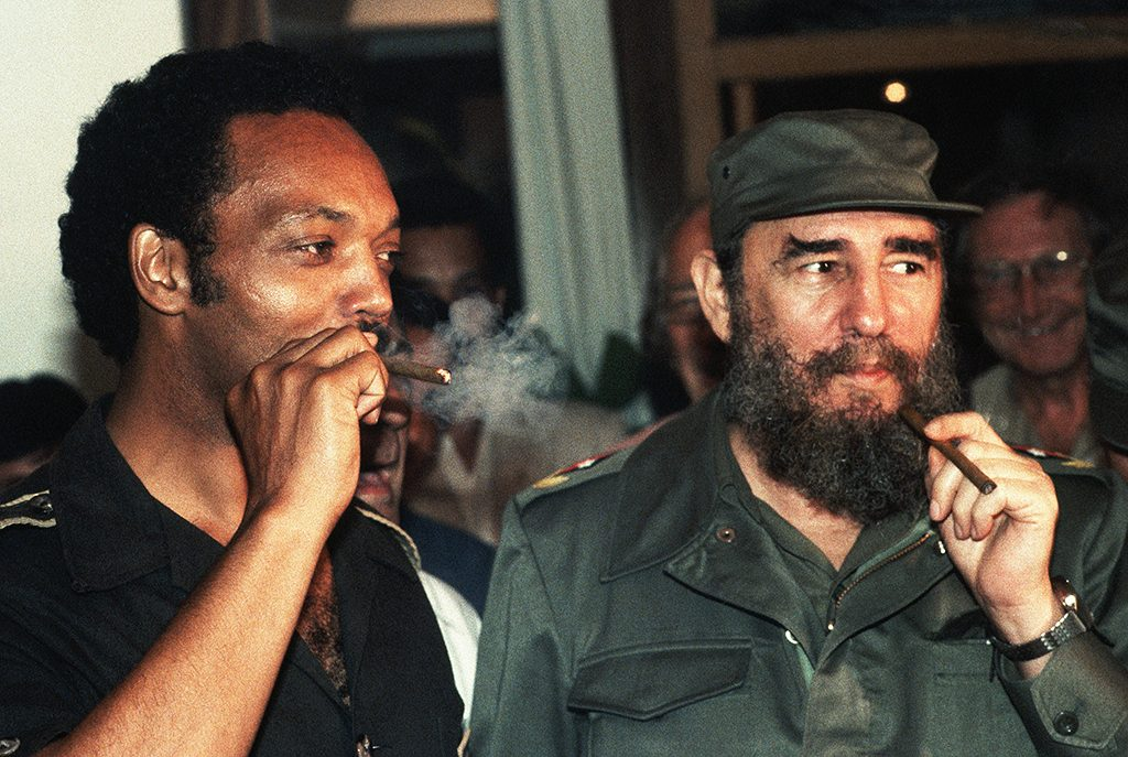 Jesse Jackson smokes Cuban cigars with Fidel Castro during a controversial visit to Havana in June 1984. Jackson, a candidate for President of the United States, caused a stir in the U.S. government and press by visiting with the Communist leader. (Photo by �� Jacques M. Chenet/CORBIS/Corbis via Getty Images)