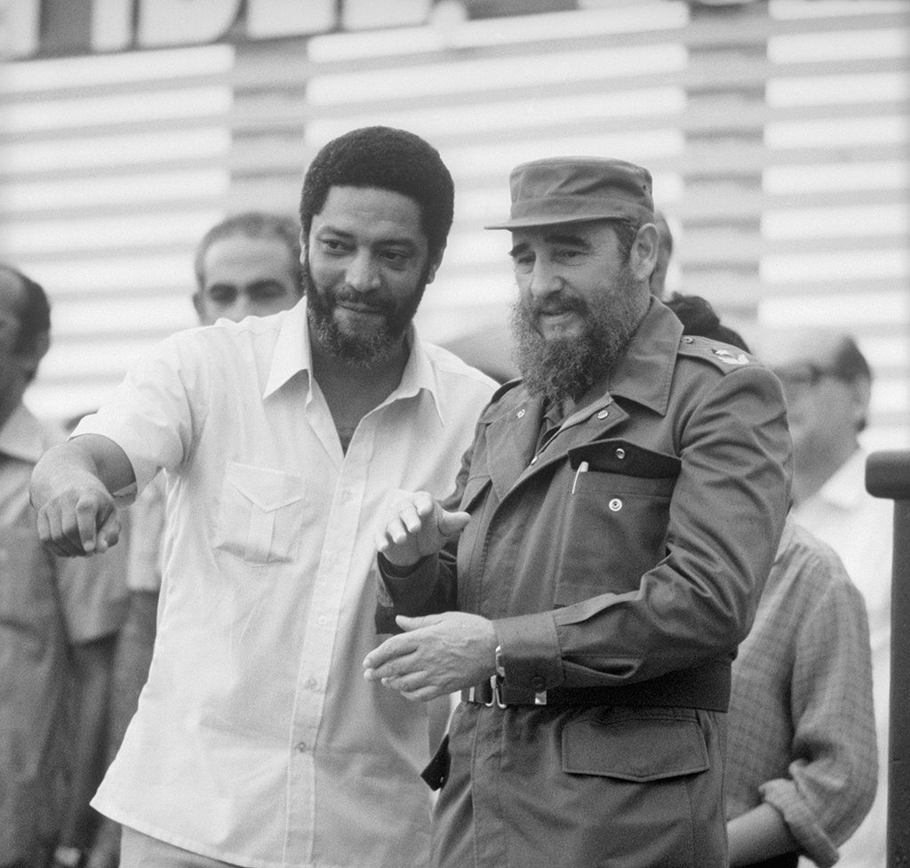(Original Caption) Prime Minister Maurice Bishop, shown here with Cuban Premier Fidel Castro at a celebration in Havana July, 1983, was shot and killed by government soldiers October 19, Grenada's military commander said. The commander said that Bishop was killed when he tried to hand out weapons to a crowd of 3,000 supporters shortly after they freed him from house arrest.