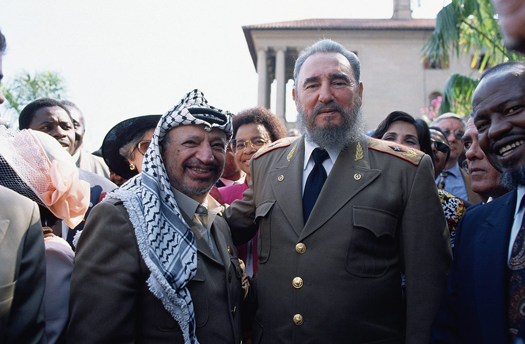 PLO leader Yasser Arafat and Cuban dictator Fidel Castro at the inauguration ceremony for South African president Nelson Mandela. (Photo by Peter Turnley/Corbis/VCG via Getty Images)