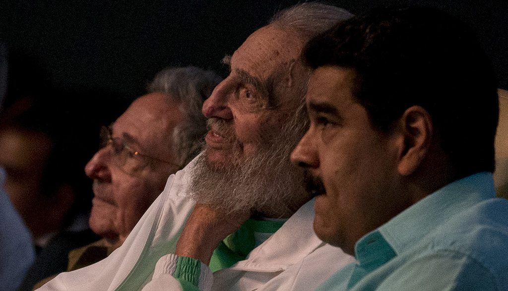 """In this handout picture released by the Cuban website www.cubadebate.cu, former Cuban President Fidel Castro (C), sitting next to Venezuelan President Nicolas Maduro (R), is seen attending the celebration of his 90th birthday at Karl Marx theatre in Havana on August 13, 2016. / AFP PHOTO / Ismael Francisco / XGTY/RESTRICTED TO EDITORIAL USE-MANDATORY CREDIT """"AFP PHOTO/CUBADEBATE.CU"""" NO MARKETING NO ADVERTISING CAMPAIGNS-DISTRIBUTED AS A SERVICE TO CLIENTS-GETTY OUT"""