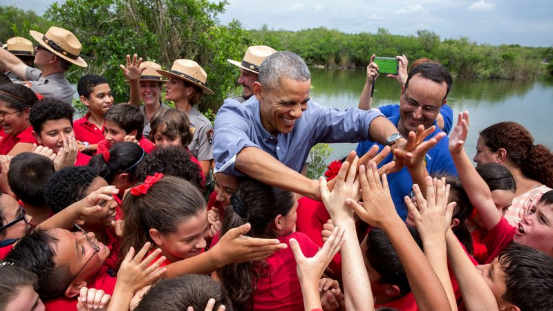 President Barack Obama greets a group of students at Everglades National Park, Fla. on Earth Day, April 22, 2015. (Official White House Photo by Pete Souza)This official White House photograph is being made available only for publication by news organizations and/or for personal use printing by the subject(s) of the photograph. The photograph may not be manipulated in any way and may not be used in commercial or political materials, advertisements, emails, products, promotions that in any way suggests approval or endorsement of the President, the First Family, or the White House.