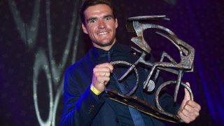Belgian cyclist Greg Van Avermaet of BMC Racing Team celebrates with his trophy during the 14th edition of the 'Gala van de Flandrien 2016' award ceremony for the best Belgian cyclist of the 2016 cycling season, organized by newspaper 'Het Nieuwsblad', on October 26, 2016, at the casino of Oostende. / AFP PHOTO / BELGA / DAVID STOCKMAN / Belgium OUT
