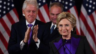 US Democratic presidential candidate Hillary Clinton makes a concession speech after being  defeated by Republican president-elect Donald Trump as former President Bill Clinton(L) and running mate Tim Kaine look on in New York on November 9, 2016. / AFP PHOTO / JEWEL SAMAD