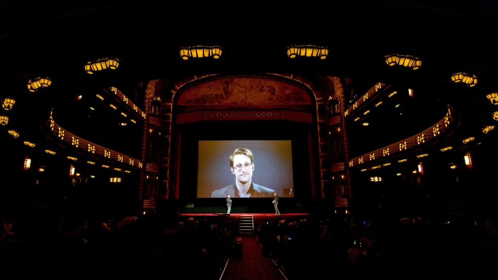 """US whistleblower Edward Snowden talks to the audience and answers questions through a live connection from Russia at the premiere of the movie """"Snowden"""" in Amsterdam, on November 10, 2016. / AFP PHOTO / ANP / Sander Koning / Netherlands OUT"""