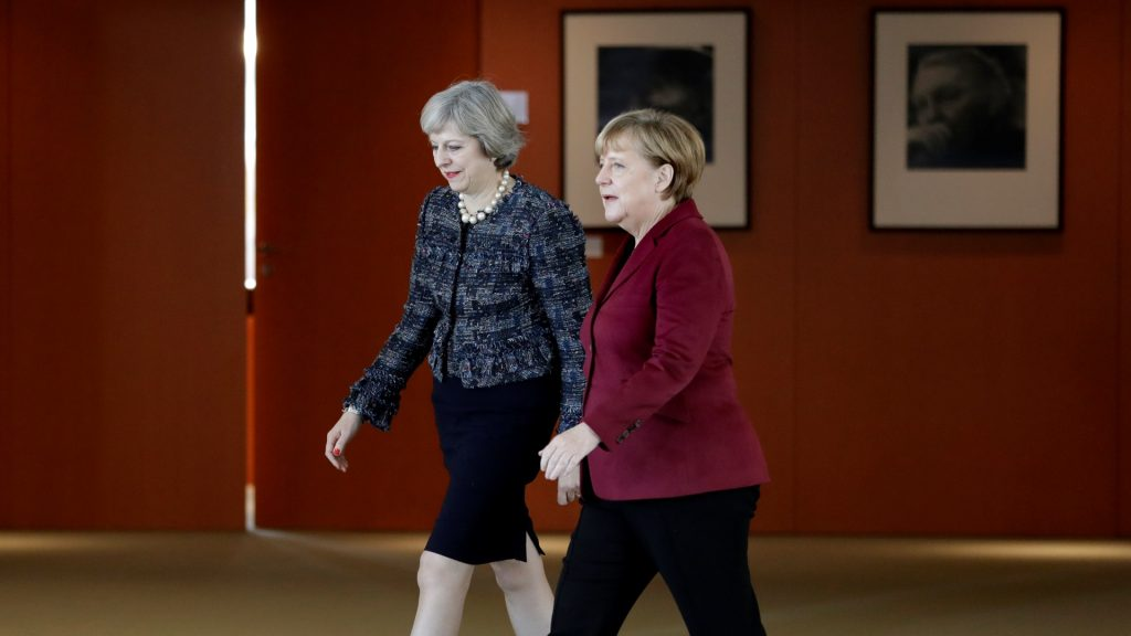 German Chancellor Angela Merkel (R) and Britain's Prime Minister Theresa May arrive for a statement prior to a meeting at the Chancellery in Berlin, Germany, on November 18, 2016. / AFP PHOTO / POOL / Michael Sohn