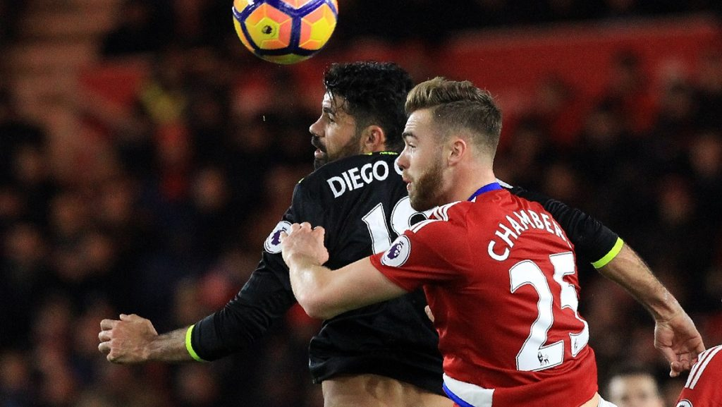 Chelsea's Brazilian-born Spanish striker Diego Costa (L) vies in the air with Middlesbrough's English defender Calum Chambers during the English Premier League football match between Middlesbrough and Cheslea at Riverside Stadium in Middlesbrough, northeast England on November 20, 2016. / AFP PHOTO / Lindsey PARNABY / RESTRICTED TO EDITORIAL USE. No use with unauthorized audio, video, data, fixture lists, club/league logos or 'live' services. Online in-match use limited to 75 images, no video emulation. No use in betting, games or single club/league/player publications.  /