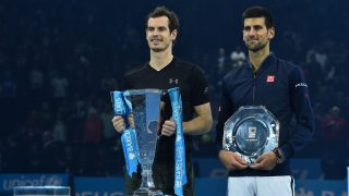 Britain's Andy Murray (L) poses with the ATP World Tour Finals trophy (L) with runner up Serbia's Novak Djokovic (R) after Murray won the men's singles final on the eighth and final day of the ATP World Tour Finals tennis tournament in London on November 20, 2016. / AFP PHOTO / Glyn KIRK