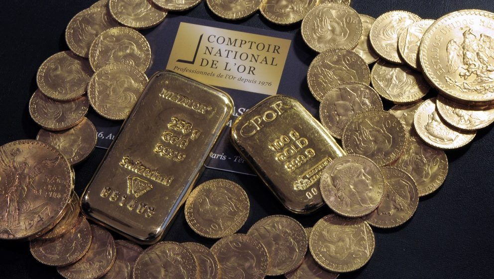 """(FILES) This file photo taken on October 05, 2012 shows Gold bars and coins displayed on a table at the Comptoir National de l'Or, a shop that buys, sales and estimates gold and jewellery in Paris.   As stated in an AFP story on November 22, 2016, a Frenchman who inherited a big house from a dead relative got more than he bargained for when he discovered a glittering treasure trove of gold coins and bars worth millions stashed around the place.Squirrelled away in hiding places throughout the house, he came across thousands of gold coins and bars weighing 100 kilogrammes (220 pounds) in total.""""There were 5,000 gold pieces, two bars of 12 kilos and 37 ingots of 1 kilo,"""" Nicolas Fierfort, a local auctioneer, told AFP, confirming a report in the local La Depeche newspaper.  / AFP PHOTO / BERTRAND GUAY"""