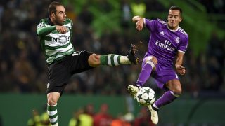 Sporting's Brazilian midfielder Bruno Cesar (L) vies with Real Madrid's forward Lucas Vazquez (R) during the UEFA Champions League football match Sporting CP vs Real Madrid CF at the Jose Alvalade stadium in Lisbon on November 22, 2016. / AFP PHOTO / PATRICIA DE MELO MOREIRA