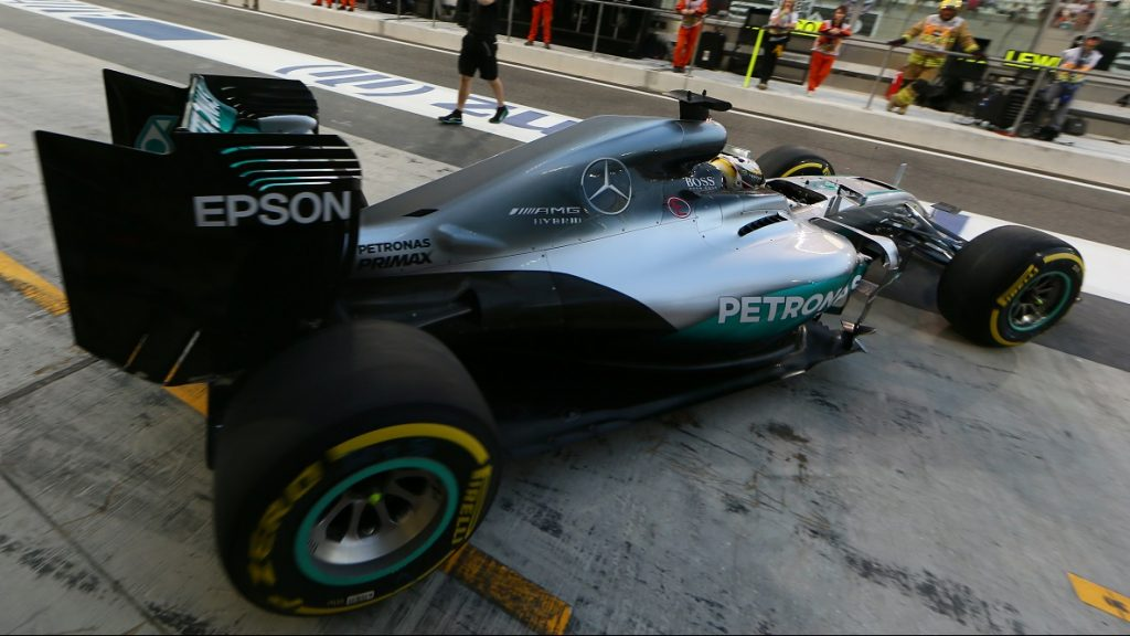 Mercedes AMG Petronas F1 Team's British driver Lewis Hamilton leaves the pits during the second practice session as part of the Abu Dhabi Formula One Grand Prix at the Yas Marina circuit on November 25, 2016. / AFP PHOTO / Karim Sahib