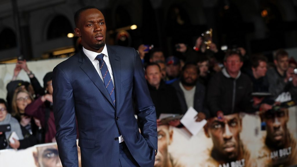 """Jamaican athlete Usain Bolt arrives to attend the World Premiere of the film """"I am Bolt"""" in central London on November 28, 2016. Bolt said he hoped the documentary would show just how hard he had worked to become one of the greatest sprinters of all time. / AFP PHOTO / Adrian DENNIS"""