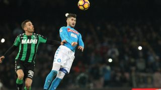 Napoli's defender from Albania Elseid Hysaj fights for the ball with Sassuolo's forward from Italy Antonino Ragusa  during the Italian Serie A football match SSC Napoli vs US Sassuolo Calcio on November 28 2016 at the San Paolo Stadium. / AFP PHOTO / CARLO HERMANN