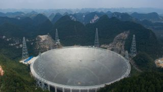 This picture taken on September 24, 2016 shows the Five-hundred-metre Aperture Spherical Radio Telescope (FAST) in Pingtang, in southwestern China's Guizhou province. Humanity's best bet at detecting aliens is a giant silver Chinese dish the size of 30 football fields -- one that simultaneously showcases Beijing's abilities to deploy cutting-edge technologies and ignore objectors' rights as it seeks global prominence. / AFP PHOTO / STR / China OUT