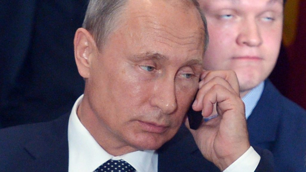 Russia's President Vladimir Putin speaks on the phone during a luncheon hosted by UN Secretary General Ban Ki-moon at the United Nations headquarters on September 28, 2015 in New York. AFP PHOTO/MANDEL NGAN / AFP PHOTO / MANDEL NGAN