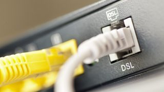 Cables and a DSL router pictured in Frankfurt Main, Germany, 20 July 2009. Photo: Frank Rumpenhorst