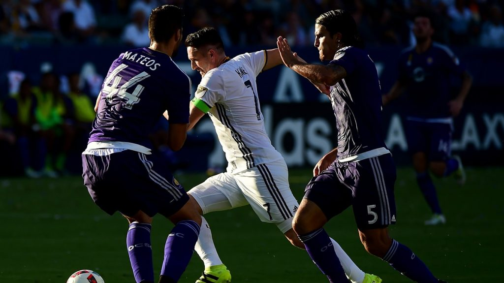 CARSON, CA - SEPTEMBER 11: Robbie Keane #7 of Los Angeles Galaxy dribbles around David Mateos #44 and Servando Carrasco #5 of Orlando City FC during a 4-2 Galaxy win at StubHub Center on September 11, 2016 in Carson, California.   Harry How/Getty Images/AFP