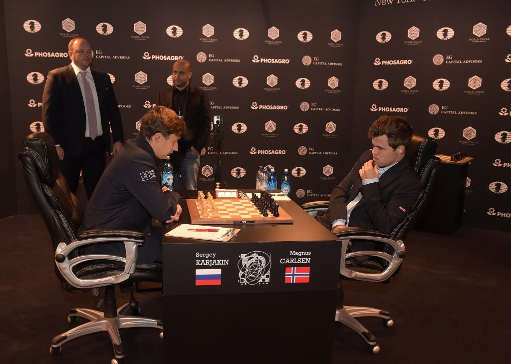 NEW YORK, NY - NOVEMBER 12: CEO and Chairman of the Management Board, PHOSAGRO Andrey A. Guryev enters to make the first move for the game between Reigning Chess Champion Magnus Carlsen and Chess grandmaster Sergey Karjakin during 2016 World Chess Championship at Fulton Market Building on November 12, 2016 in New York City.   Jason Kempin/Getty Images for Agon Limited/AFP