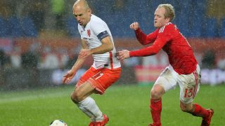 Arjen Robben competes with Jonathan Williams during the International friendly football match between Wales v Netherlands played at Cardiff City Stadium, Cardiff on 13th November 2015. Photo Paul Greenwood / BPI / DPPI
