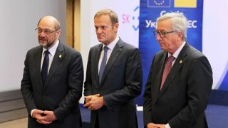 BRUSSELS, BELGIUM - NOVEMBER 24: European Parliament President Martin Schulz (L), European Council President Donald Tusk (2nd R) and European Commission President Jean-Claude Juncker (R) wait to welcome Ukraine's President President Petro Poroshenko (2nd L) for the 18th EU-Ukraine summit at the European Commission in Brussels, Belgium on November 24, 2016.  Dursun Aydemir / Anadolu Agency
