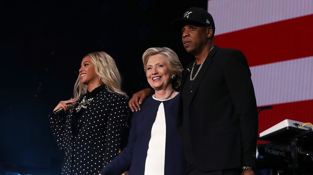 CLEVELAND, OH - NOVEMBER 04:  (L-R) Beyonce, Democratic presidential nominee former Secretary of State Hillary Clinton and Jay Z appear on stage during a Get Out The Vote concert at Wolstein Center on November 4, 2016 in Cleveland, Ohio. With less than a week to go until election day, Hillary Clinton is campaigning in Pennsylvania, Ohio and Michigan.  (Photo by Justin Sullivan/Getty Images)