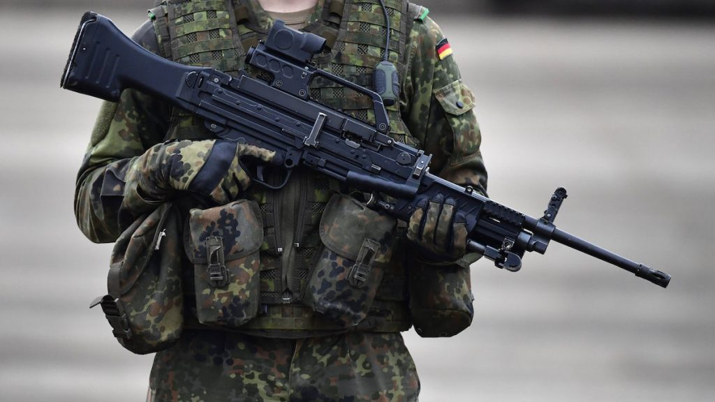 """BERGEN, GERMANY - OCTOBER 14: A German soldier holds a machine gun MG4 during the """"Land Operations"""" military exercises during a media day at the Bundeswehr training grounds on October 14, 2016 near Bergen, Germany. The exercises are taking place from October 4-14. Nations across Europe having been strengthening their joint military capabilities and cooperation in recent years as a response to growing Russian military assertion that has included intervention in Ukraine and military flights into European airspace as well as the recent stationing of Iskander nuclear-capable missiles in Kaliningrad. (Photo by Alexander Koerner/Getty Images)"""