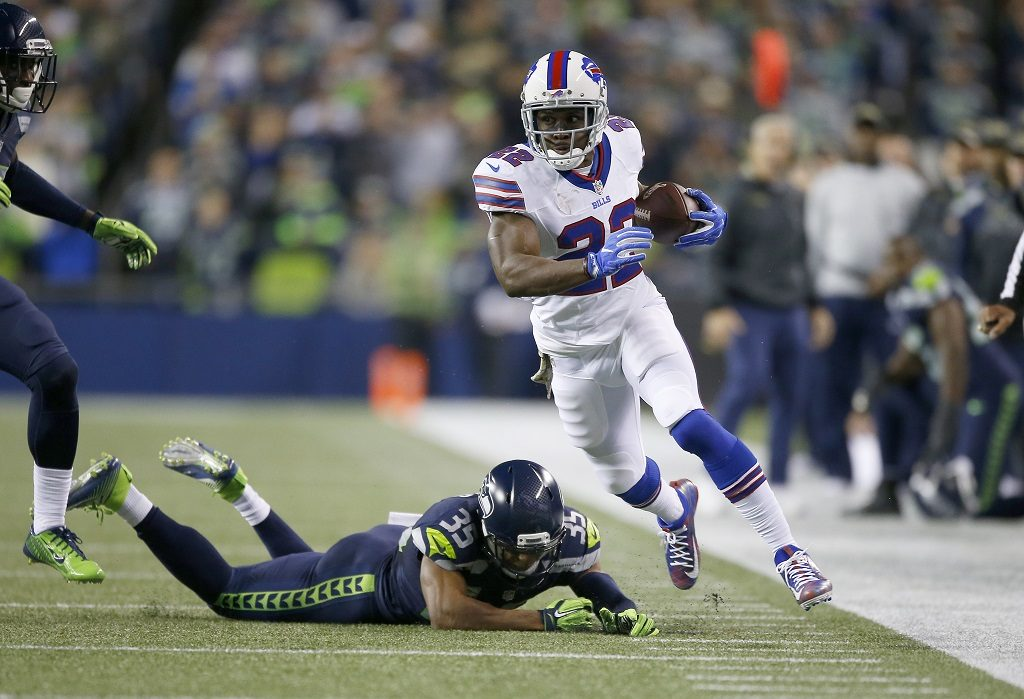 SEATTLE, WA - NOVEMBER 07: Running back Reggie Bush #22 of the Buffalo Bills rushes against defensive back DeShawn Shead #35 of the Seattle Seahawks at CenturyLink Field on November 7, 2016 in Seattle, Washington.   Otto Greule Jr/Getty Images/AFP