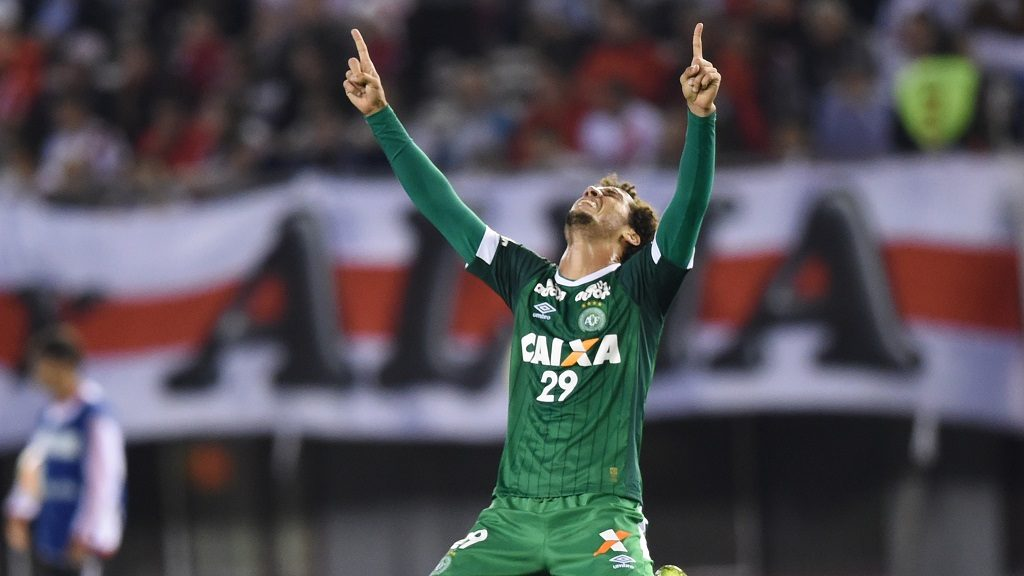 (FILES) This file photo taken on October 21, 2015 shows Brazil's Chapecoense defender Neto celebrating after his team scored a goal against Argentina's River Plate during the Copa Sudamericana 2015 quarterfinals first leg football match at the Monumental stadium in Buenos Aires, Argentina. A plane carrying 81 people, including members of a Brazilian football team, crashed late on November 28, 2016 near the Colombian city of Medellin, officials said. One of the survivors is Chapecoense Real's football player Helio Hermito Zampier Neto, who is being evacuated, according to the National Unit of Risk Management (UNGRD). / AFP PHOTO / EITAN ABRAMOVICH