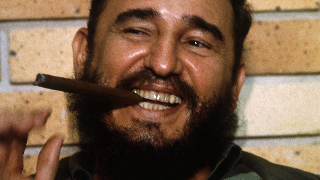(Original Caption) Cuban Premier Fidel Castro flashes a big smile as he puffs a cigar, during an interview by American newsmen accompanying Senators Jacob K. Javits, (R-N.Y.), and Clairborne Pell, (D-RI), on a recent visit.
